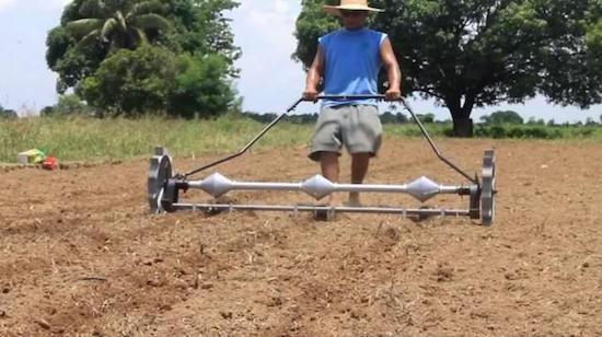 Mechanical corn planter