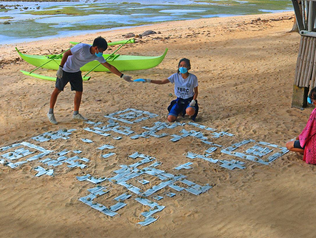 Rizza Mae Hibaya and her friends creating the QR Code on Tag-ulo beach.