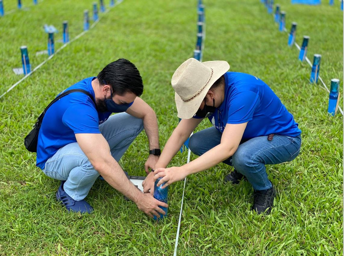 The team sets up the solar lamps to form the Philippine flag.